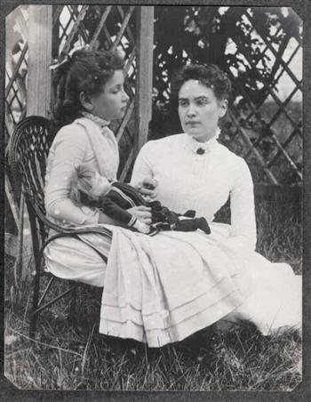 Hellen_Keller_holding_doll_with_Ann_Sullivan_1888