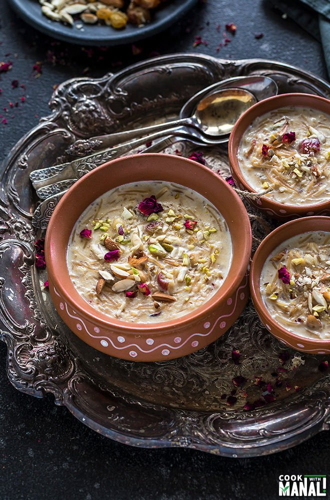 Sheer Khurma served in clay pots in a silver tray